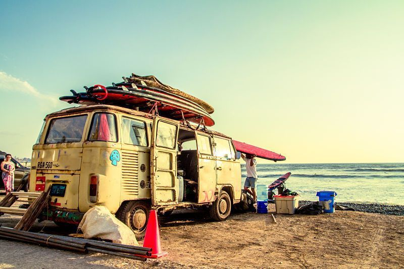 Hippie Surfboard Van on the beach color processed